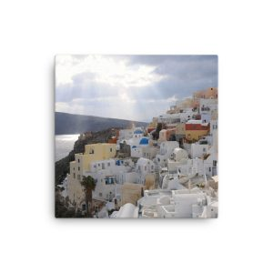 Sun Rays Fall on the Famous Village of Oia on the Greek island of Santorini on Canvas