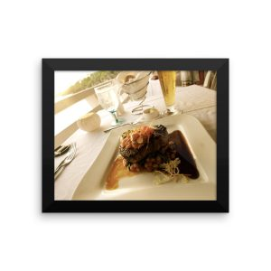 A Succulent Filet Cut on a Plate Overlooking the Atlantic Ocean in Bermuda in a Framed poster