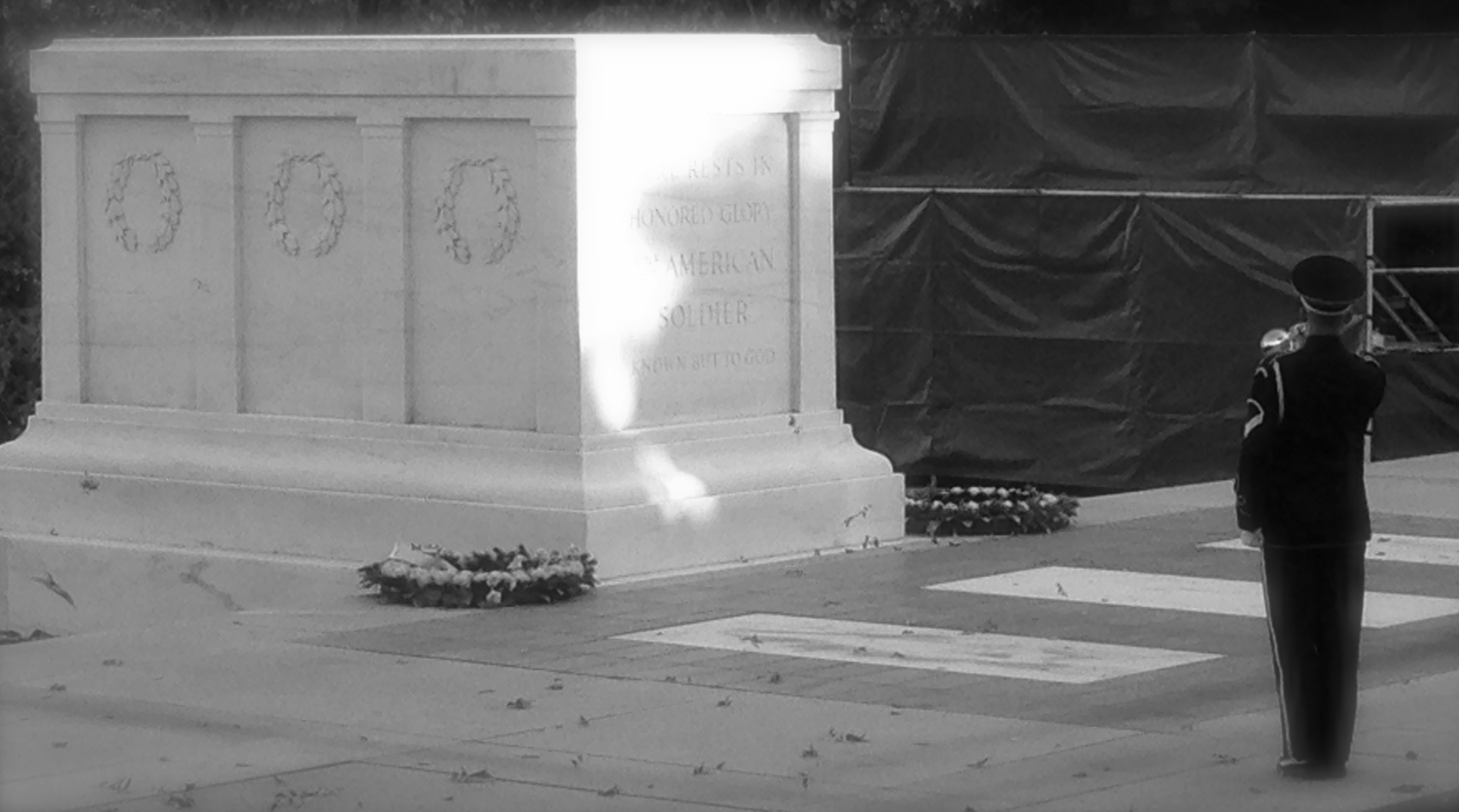 Solitary soldier performing Taps at the Tomb of the Unknown Soldier at Arlington National Cemetery, Washington DC