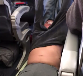 Dragged From Plane Overbooked United Airlines