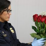 CBP Inspector with roses at MIA airport Miami Valentine's Day 2018