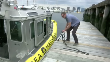 Self-driving boats with man at boston harbor pier VOA News